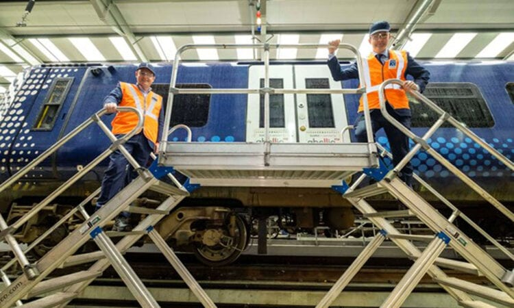 Scotland rail workers pose with Abellio carriage