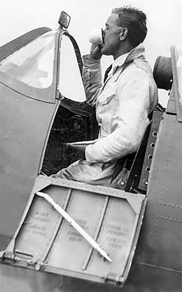 Sometimes there was no time to stop between test flights – Alex grabs a hasty cup of tea in the cockpit of a Spitfire at Castle Bromwich.