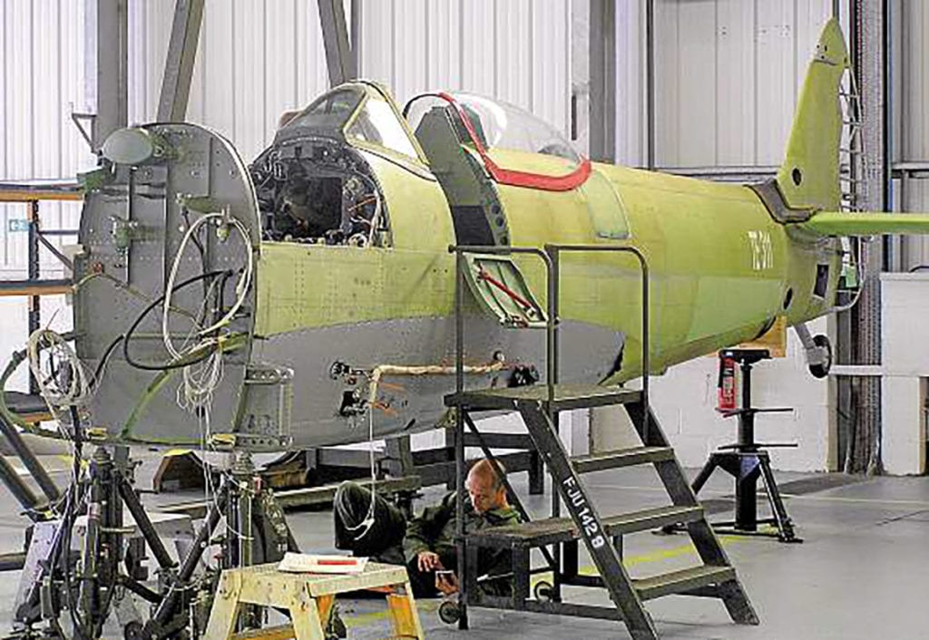 With restoration at Coningsby under way, TE311's fuselage is seen with rivetting complete and awaiting engine bearer frames. All via author