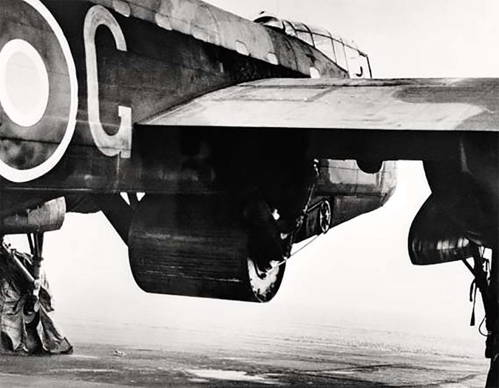 A practice Upkeep weapon fitted to Wg Cdr Guy Gibson's Type 464 Provisioning Lancaster, ED932 AJ-G, at Manston, Kent, while conducting dropping trials off Reculver. The 10,000lb Upkeep mine was held in the modified bomb bay area between a pair of side-swing calipers and was rotated at 500rpm before being released, via a belt drive, by a hydraulic motor mounted in the forward fuselage. IWM HU69915