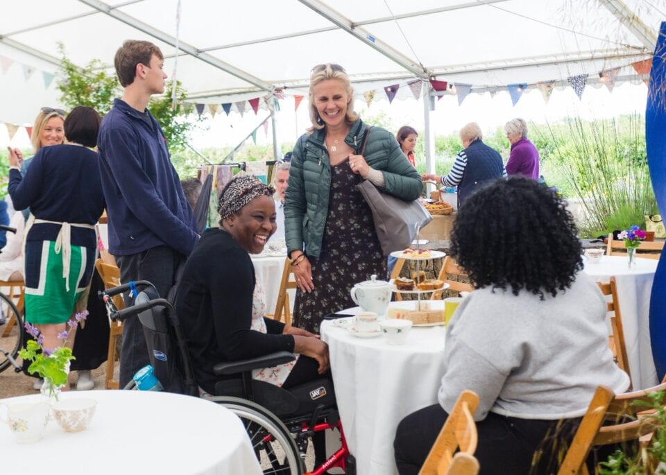 The Countess of Radnor enjoying an afternoon with patients and their loved ones at The Fabulous Summer Tea Party in Horatio's Garden South West (Credit: Josh Humphrey, 2019)