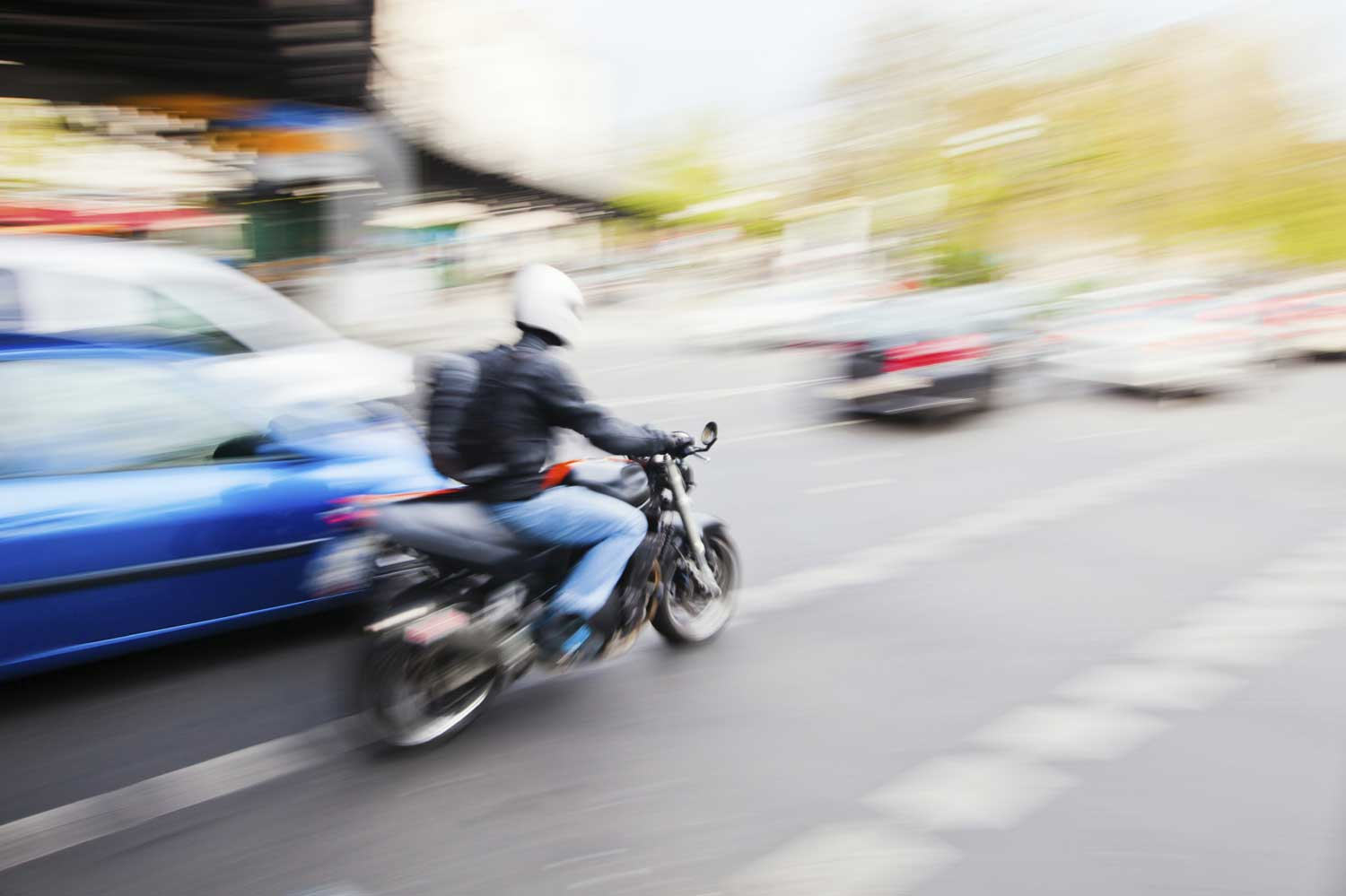 Biker through traffic