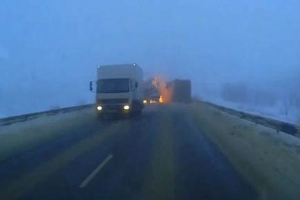 Driver-skims-through-the-middle-of-fireball-motorway-crash (1)