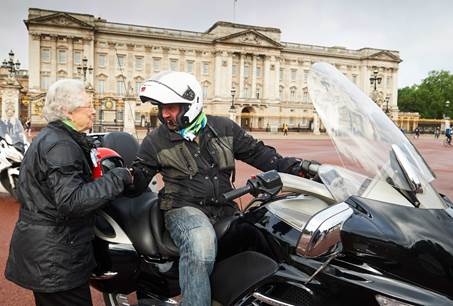 'The Queen' thanks her Carole Nash biker for her ride to work Photo credit: Carole Nash