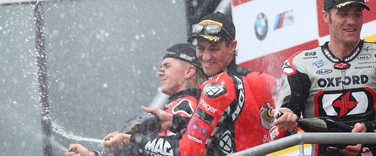 Josh Brookes stands at the top of the podium after race two of the British Superbikes Championship at Brands Hatch.