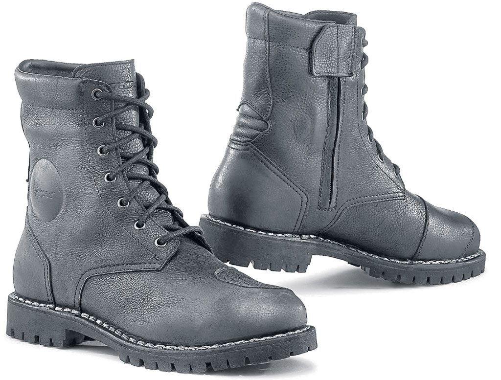 A pair of black biker boots on a white background.